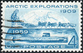 "Postage stamps printed in USA, Conquest of the Arctic by land by Rear Admiral Robert Edwin Peary in 1909 and by sea by the submarine ""Nautilus"" in 1958, shows the North Pole Dog Sled and ""Nautilus"" — Stock Photo"