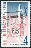 A postage stamp printed in the USA, dedicated to the Centenary of the US-Japan Treaty of Amity and Commerce, shows Washington Monument and Cherry Blossoms — Stock Photo