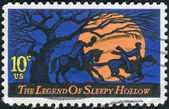 A postage stamp printed in USA, Legend of Sleepy Hollow, by Washington Irving. Design features Headless Horseman pursuing Ichabod Crane — Stok fotoğraf