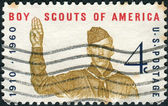 A postage stamp printed in the USA, dedicated to the 50th Anniversary Boy Scouts of America, shows Boy Scout Giving Scout Sign — Stock Photo