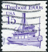 A postage stamp printed in USA, shows a tugboat 1900s — Stock Photo
