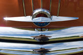 The emblem on the hood of a two-door coupe Pontiac Star Chief, First generation (1954) — Stock Photo