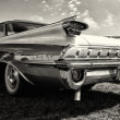 Stock Photo: Full-size automobile Oldsmobile 98 (Ninety-Eight), rear view, sepia