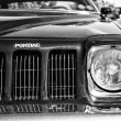 Stock Photo: Headlamp Mid-size car Pontiac Grand Am, (black and white)