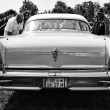 Постер, плакат: Personal luxury car Buick Series 700 Limited Hardtop Sedan 1958 black and white rear view