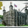 A postage stamp printed in the UK, British Architecture, shows the White Tower in London — Stock Photo