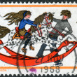 A postage stamp printed in the UK, Christmas Issue, shows Boy and Girl with Rocking Horse — Stock Photo