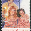 AUSTRALIA - CIRCA 1987: Postage stamp printed in Australia, Christmas Issue, shows a man and two girls singing Christmas songs, circa 1987 — Stock Photo