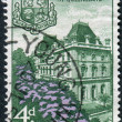 Stock Photo: AUSTRALIA - CIRCA 1959: Postage stamp printed in Australia, dedicated to Centenary of Queensland self-government, shows Parliament House, Brisbane and Queensland Arms, circa 1959