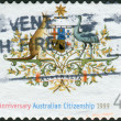 Stock Photo: AUSTRALI- CIRC1999: Postage stamp printed in Australia, dedicated to 50th anniversary of Nationality and Citizenship Act, shows State Emblem, circ1999