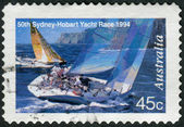 AUSTRALIA - CIRCA 1994: Postage stamp printed in Australia, dedicated to the 50th anniversary of the international sailing race Sydney-Hobart, shows Two yachts abeam, circa 1994 — Stock Photo