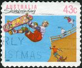 AUSTRALIA - CIRCA 1990: Postage stamp printed in Australia shows Skateboarding, circa 1990 — Stockfoto