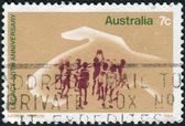 AUSTRALIA - CIRCA 1973: Postage stamp printed in Australia, dedicated to the 50th anniversary of Legacy, shows Hand Protecting Playing Children, circa 1973 — Stock Photo