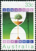 AUSTRALIA - CIRCA 1985: Postage stamp printed in Australia, is dedicated to protecting the environment, shows tree, circa 1985 — Stock Photo