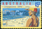 AUSTRALIA - CIRCA 1994: Postage stamp printed in Australia, dedicated to the 100th anniversary of the Royal Life Saving Society, shows Vigilance, circa 1994 — Stock Photo