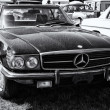 Stock Photo: PAAREN IM GLIEN, GERMANY - MAY 19: two-door coupe Mercedes-Benz C107 (560SL), black and white, US version, oldtimer show in MAFZ, May 19, 2013 in Paaren im Glien, Germany
