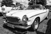 PAAREN IM GLIEN, GERMANY - MAY 19: Sports car Volvo P1800S, black and white, The oldtimer show in MAFZ, May 19, 2013 in Paaren im Glien, Germany — Stock Photo