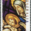 AUSTRALIA - CIRCA 1995: Postage stamp printed in Australia, Christmas Issue, shows Stained glass windows, Our Lady Help of Christians Church, Melbourne: Madonna and Child, circa 1995 — Stock Photo #40703189