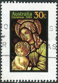 AUSTRALIA - CIRCA 1984: Postage stamp printed in Australia, Christmas Issue, shows Stained glass windows, Veiled Virgin and Child, circa 1984 — Stock Photo