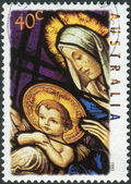 AUSTRALIA - CIRCA 1995: Postage stamp printed in Australia, Christmas Issue, shows Stained glass windows, Our Lady Help of Christians Church, Melbourne: Madonna and Child, circa 1995 — Stock Photo