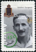 "AUSTRALIA - CIRCA 1995: Postage stamp printed in Australia shows Famous Australians from World War II, Soldier Surgeon Sir Edward ""Weary"" Dunlop, circa 1995 — 图库照片"