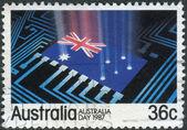 AUSTRALIA - CIRCA 1987: Postage stamp printed in Australia, is dedicated to Australia Day, shows Flag, circuit board, circa 1987 — Stock Photo
