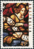 AUSTRALIA - CIRCA 1995: Postage stamp printed in Australia, Christmas Issue, shows Stained glass windows, Our Lady Help of Christians Church, Melbourne: Angel carrying banner, circa 1995 — Stock Photo