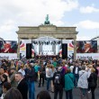 Citizens and guests of city near Brandenburg Gate. Day of GermUnity is national day of Germany — Stock Photo #41034513