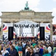 Citizens and guests of city near Brandenburg Gate. Day of GermUnity is national day of Germany — Stock Photo #41034549
