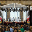 Stock Photo: Choir near Brandenburg Gate. Day of GermUnity is national day of Germany