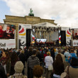 Citizens and guests of city near Brandenburg Gate. Day of GermUnity is national day of Germany — Stock Photo #41035439