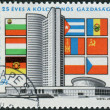 Stock Photo: Postage stamp printed in Hungary, dedicated to 25th anniversary of Council of Mutual Economic Assistance, depicted CMEbuilding in Moscow and flags of participating countries
