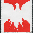 Stock Photo: Postage stamp printed in Poland devoted to 36 anniversary of Polish People's Republic, shows Mwith raised hand and flag