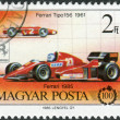 Stock Photo: Postage stamp printed in Hungary, devoted to 100th anniversary of car, shows Ferrari Tipo 156 and Ferrari Formul1,1985
