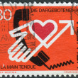 SWITZERLAND - CIRCA 1975: Postage stamp printed in Switzerland, shows a helping hand, circa 1975 — Stock Photo #42063763