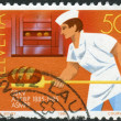 Stock Photo: SWITZERLAND - CIRC1985: Postage stamp printed in Switzerland, dedicated to Centenary Confectioners Federation, Bern, shows Swiss Master Bakers, circ1985