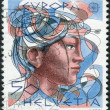 Stock Photo: SWITZERLAND - CIRC1986: Postage stamp printed in Switzerland, dedicated to Europe, shows woman's head, circ1986