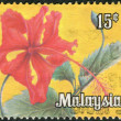 Stock Photo: Postage stamp printed in Malaysia, flower shows Hibiscus