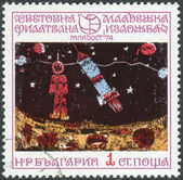 Postage stamp printed in Bulgaria, devoted to Youth Stamp Exhibition '74: Children's Drawings, shows Exploration of outer space for peaceful purposes — Stock Photo