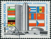 Postage stamp printed in Hungary, dedicated to the 25th anniversary of Council of Mutual Economic Assistance, depicted CMEA building in Moscow and the flags of the participating countries — Stock Photo