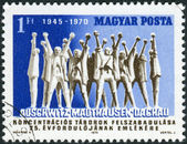 Postage stamp printed in Hungary, dedicated to the 25th anniversary of Liberation of concentration camps, shows monument in Mauthausen-Gusen concentration camp — Stock Photo