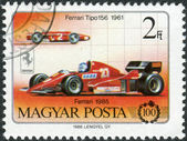 Postage stamp printed in Hungary, devoted to the 100th anniversary of the car, shows Ferrari Tipo 156 and Ferrari Formula 1,1985 — Stock Photo