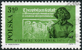 """POLAND - CIRCA 1972: Postage stamp printed in Poland, shows Copernicus with lily of the valley, and page from Theophilactus Simocatta's """"Letters on Customs"""", circa 1972 — Stock Photo"""