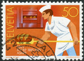 SWITZERLAND - CIRCA 1985: Postage stamp printed in Switzerland, dedicated to Centenary Confectioners Federation, Bern, shows Swiss Master Bakers, circa 1985 — 图库照片