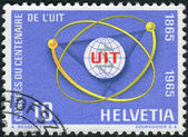 SWITZERLAND - CIRCA 1965: Postage stamp printed in Switzerland, dedicated to Centenary of the ITU, shows ITU Emblem and Atom Diagram, circa 1965 — Stock Photo