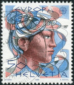 SWITZERLAND - CIRCA 1986: Postage stamp printed in Switzerland, dedicated to Europe, shows a woman's head, circa 1986 — Stok fotoğraf