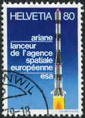 SWITZERLAND - CIRCA 1979: Postage stamp printed in Switzerland, shows Three-stage Launcher Ariane, circa 1979 — Stock Photo