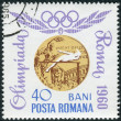Stock Photo: Postage stamp printed in Romania, dedicated to High jump - RomOlympics, 1960, gold medalist IolandBalas
