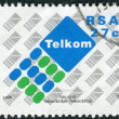 Stock Photo: Postage stamp printed in South Africa, shows emblem of Telkom
