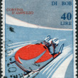 Stock Photo: Postage stamp printed in Italy, dedicated to World Bobsleigh Championships, shows Two-mbobsleigh